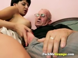 old man touching young girl