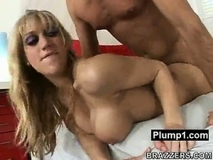 Squeezing huge boobs