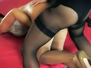Two hot horny lesbians using strap