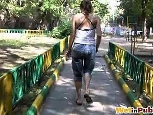 Self-wetting lady changes pants outdoors