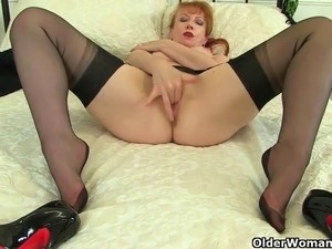 UK milfs Red and Holly Kiss wear stockings with suspenders and give their...