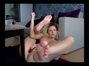 Sexy blonde showing soles