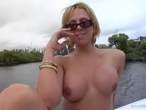 Erotic solo model with tattoo fondling her fake tits before fingering her...